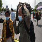 أول بؤرة لفيروس كورونا تعود لطبيعتها.. والآلاف يغادرونها